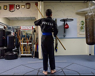 The Vindicator/Geoffrey Hauschild.Ben Powell, 13 of Youngstown, practices with a bo during a karate lesson at AE Vea Karate along Belmont Ave. on Friday afternoon..