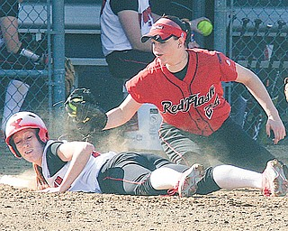 Autumn Grove of Youngstown State beats the tag by St. Francis' Taylor Darneille (25) during the first game of a nonconference doubleheader Thursday at McCune Park in Canfi eld. The Red Flash swept the Penguins, 3-1 and 4-3.