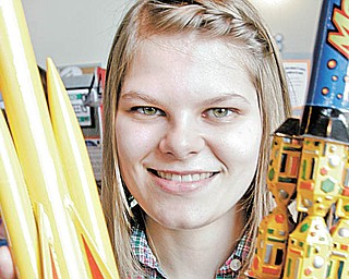 William D. Lewis| The Vindicator Melissa Moliterno, 16, of Canfield and a 4H member for 14 years shows off model rockets she helped  build as 4H projects. She was attending 4-H community Day at Lord of Life Luthern Church in Canfield Saturday 3-20-10.