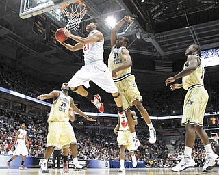 Ohio State's Evan Turner (21) goes for a basket against Georgia Tech's Zachery Peacock (35), Gani Lawal (31) and D'Andre Bell, right, in the first half of an NCAA second-round college basketball tournament game in Milwaukee, Sunday, March 21, 2010. (AP Photo/Jeffrey Phelps)
