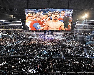 Manny Pacquiao, of the Philippines, is seen on a large video screen before his WBO boxing welterweight title fight against Joshua Clottey, from Ghana, in Cowboys Stadium in Arlington, Texas, Saturday, March 13, 2010.