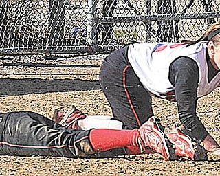 YSU SOFTBALL - (2) Kristina Rendle can't come up with the ball as (15) Heather Stiglich slides in safe Thursday afternoon in Canfield. - Special to The Vindicator/Nick Mays