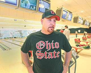 Greg Morris of Sharpsville, Pa., talks about his job search after bowling at Camelot Lanes. The Boardman alley had a jobs fair Wednesday in which job seekers received two free games of bowling.
