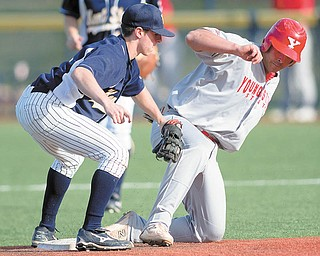 YSU's Anthony Porter (24) is tagged out at second by Kent State Jimmy Rider (1) during the top of the eighth inning of a game at Kent State's Schoonover Stadium on Wednesday afternoon.