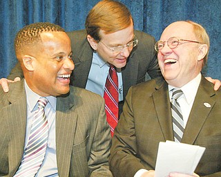 Retiring YSU pres Dr. David Sweet, right shares a laugh with Mayor Jay Williams, left, and Bob Shroder Pres/Ceo of Humility of Mary Health Partners during Chamber annual business meeting Thursday 3-25-10 at Mr Anthony's.Williams was awarded thechamber's Politcal Achievement award.
