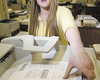 Veronica Skowron, a Mahoning County Board of Elections employee, prints a paper ballot to be used by a voter at the board office on Market Street in Youngstown. Those wanting to vote early in the May 4 primary can do so now.