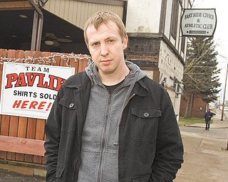 James Rhodes, 31, from England, is in Youngstown to write books about living on the city's South Side, the Youngstown boxing community and the city's support of middleweight boxing champion Kelly Pavlik. He is in front of a favorite Pavlik hangout, East Side Civics & Athletic Club, located on South Avenue.
