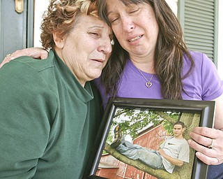 ROBERT K. YOSAY | THE VINDICATOR..Rose ( ex mother in law) and Jill (mom ) Sherbourne  hold a photo of Joshua their ( son /grandson) who was killed in a pile up in Warren Twp. on his way to Cleveland to finish his induction into the Marine Corp.-30