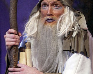 William D. Lewis The Vindicator Jim Courim of Niles portrays John the Revalator during Passion Play at Highway Tabernacle in Austintown. He served as a narrator for the production.