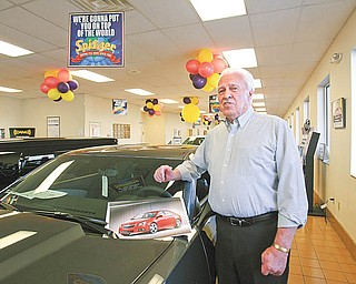 Bobby Thomas, a GM Lordstown retiree, checks out vehicles in the showroom of Spitzer Chevrolet in North Jackson. Thomas traded in his Chevrolet Impala earlier this year and bought a used Pontiac while he waits on the Lordstown-build Cobalt. He plans on buying one when they hit showrooms later this year.