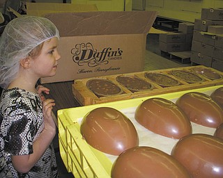 Savannah Wymer, daughter of Marion and Jeff Burns of North Lima, was one of several children and adults during a tour at DaffinÕs Candy Factory in Sharon, Pa., to see how Easter candy is made..