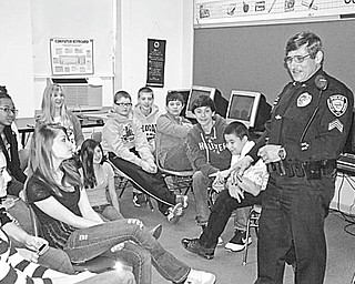 The Vindicator: A Substance Abuse Prevention program was presented recently for pupils in the seventh- and eighth-grade classes at St. Patrick School in Hubbard. The difference between street and medically prescribed drugs, the reasons people abuse drugs and the consequences of making bad choices with drugs were explained by, right, Sgt. Lou Carsone of the Hubbard City Police Department. The program also included a video documentary about the life of a person with a life-changing drug problem and a question-and-answer session.