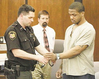 A deputy sheriff removes Maurice Clarett's handcuff s during a courtroom hearing Wednesday in Columbus. The judge cleared the way for the former Ohio State football star to be transferred to a smaller detention facility in the city.