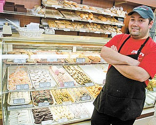 Frank Occhibove literally grew up in the aisles of Jimmy's Italian Specialties, which his parents started in his grandfather's garage on West Federal Street in Youngstown in 1974. Here Occhibove, manager of the store on Belmont Avenue in Liberty, stands in front of its bakery.
