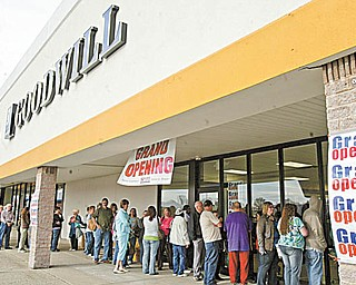 A line of about 150 people waited Thursday morning outside the new Austintown Goodwill location in the Austintown Plaza. The store's grand opening continues through Saturday, and all donated merchandise is 50 percent off.