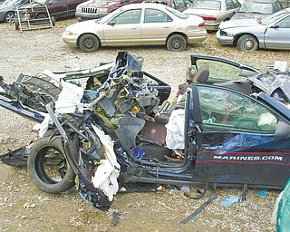 Three Trumbull County Marine Corps recruits died after this Pontiac G6 was struck March 31 by a tractor trailer truck on state Route 5 in Leavittsburg. The damage shown here was caused not only by the crash, but also by the Jaws of Life and other equipment used to free the occupants.