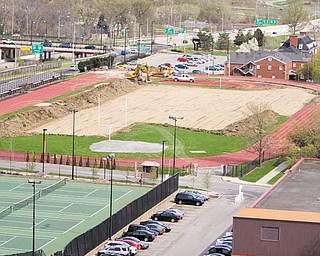 Youngstown State University began preparing for the WATTS Center, background, on Monday. The university hopes to have the facility completed by the end of this year.