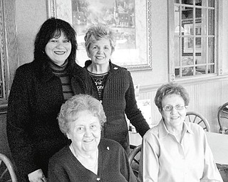 The Vindicator: All set for the recognition dinner to be sponsored by the Yo-Mah-O Chapter of International Association of Adminstrative Professionals are, from left, seated, Marie Sammartino and Carmella DiGaetano, and standing, Olga Rivera and Bonnie Filipovich, club members.