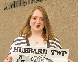 Tori Sylvester, a sophomore at Hubbard High School, shows off her winning entry in a flag-design contest sponsored by Hubbard Township. She was recognized at a trustees meeting this week. Tori used an eagle prominently in the design because it's the mascot of the school's athletic teams.
