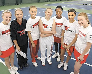 Members of the Youngstown State tennis team. From left, Nicole Haralambopoulos, head coach Michele Grim, Anna Volkova, Lauren Hankle, Tanisha Welch, Hannah Patten and Margarita Sadovnikova. The women hope senior leadership, provided by Haralambopoulos, Volkova and Welch, will help the Penguins to succeed in the Horizon League tournament later this month. The Penguins (6-12) have played all of their Horizon League
