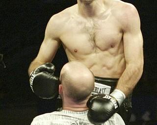 William D. Lewis| The Vindicator  Chris Hazimahalis is lefted by trainer Johnny Loew after ko in Ramon ellis