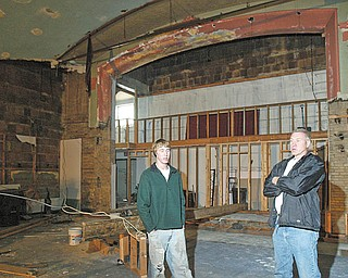 """Don Elzer, right, is renovating a former movie theater in East Palestine for use as a community theater. He and his son Dan Elzer, left, are shown in the theater. They are part of the East Palestine Community Theater group, which tentatively plans to open the theater early next month. After opening with """"South Pacific"""" and """"The Wizard of Oz"""" this spring and summer, the group plans a full season of productions in 2010-11."""