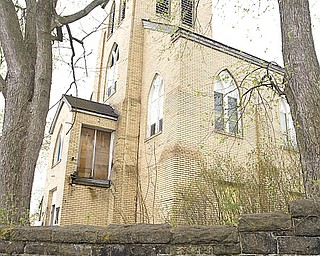 The side of the former St. Mary's Byzantine Church at Florence Avenue and Salt Springs Road on Youngstown's West Side. A local man is behind the Sacred Places Dialogue. The concept is based on a nationwide grass-roots movement on how to preserve sacred sites that once served as houses of worship and gathering places for ethnic groups.