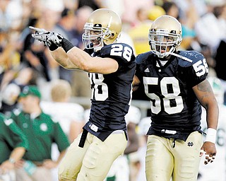 Notre Dame safety Kyle McCarthy, left, celebrates a last-minute interception in front of teammate Brian Smith during a September game in South Bend, Ind.
