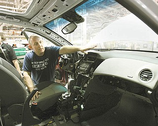 Austintown, a launch team member, points out the 10 airbags inside the Cruze. The airbags are deployed 