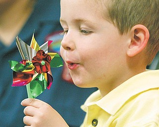 Samuel McPherson, 3, son of Paul and Amy McPherson of Boardman, attended the fifth annual Pinwheels for Prevention at Akron Children's Hospital Beeghly Campus in Boardman. Samuel's brother, Maxwell, of Cub Scout Pack 89, led the Pledge of Allegiance to start Thursday's event.