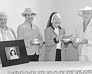 Nick Mays | The Vindicator: Sampling tea to be served by the Ladies of Charity at the annual Tea For Green on May 2 are , from left, Betty Conway, President; Dee Balogh, co-chairwoman; Sister Lois Walter, and Jacqueline Price, chairwoman.