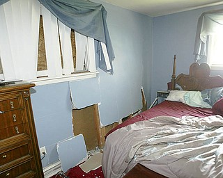 This is John Mrakusic's bedroom as it appeared Saturday after a car ran into his brick ranch house at 525 Cynthia Drive in Campbell. Three of the car's occupants died in the 5 a.m. crash.