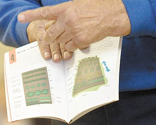 Harding shows examples from a book of what not to do when it comes to gardening.