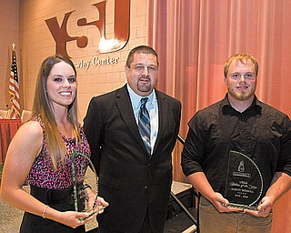 Katie Rogner, left, of the women's golf team and Aaron Merrill, right, of the men's track & field team were named Youngstown State/Vindicator Athletes of the Year at the annual Scholar-Athlete Banquet on Tuesday night. They were presented their awards by Vindicator sports editor Rob Todor, center.