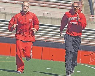 Adam Kagarise and Tarelle Irwin run during practice at Stambaugh Stadium.