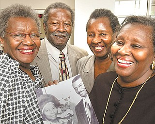 The children of the late Ruby and the Rev. Fred Shuttlesworth (in the photo) carry on the legacy of their father. From left, Ruby Shuttlesworth Bester, Fred Shuttlesworth Jr., Carolyn Shuttlesworth and Patricia Shuttlesworth Massengill .