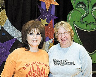 """Mineral Ridge High School art teacher Pam Plesea, left, is retiring this year after 39 years, leaving behind a legacy in her extracurricular directorship of the popular variety show """"Escapades."""" Here she stands on stage at the high school with """"Escapades'"""" costume designer Cheryl George."""