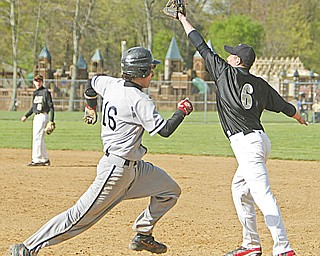 Howland's Nick Marino is out at fi rst as Harding's Will Frazier makes the catch in the second inning of Wednesday's game at Howland.