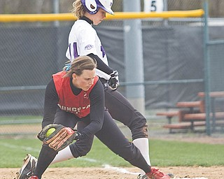 Youngstown State fi rst baseman Kim Klonowski stretches to retire Niagara's Beck Zill (14) in the fi rst game of a doubleheader at McCune Park on Wednesday. The Penguins split the games, winning the fi rst 15-10, and losing the second 12-2.