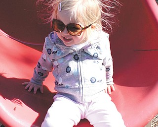 """Payton Zwingler, 2 1/2, was """"ecstatic"""" about playing at Tot's Town in Boardman Park. She is the daughter of Chad and Alyson Zwingler of Columbiana."""