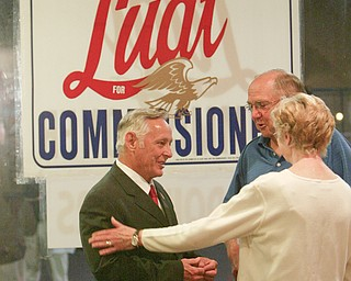 ROBERT K. YOSAY | THE VINDICATOR..Dave Ludt  gets a handshake from George and Marian Kluchar of Boardman . at Ludts Campaign HQ in Boardman Plaza -30-