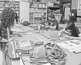 Busily creating some of the art to be entered in a two-day art show at Canfield High School are senior students, from left, Melanie Shoenfield, advanced drawing; Caroline Sauer, advanced drawing; and Breland Cockrell, three-dimensional design.