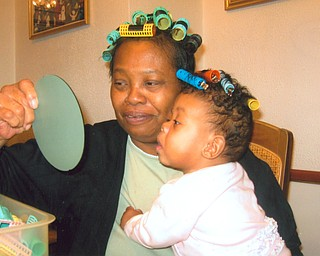 Just for fun, Donna Clayton of Youngstown shared her hair rollers with her granddauhter, Saria Drake of Youngstown.