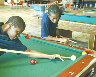 Tamboura Jenkins, left, and David Williams, both 12, are members of Boys and Girls Club of Youngstown. The organization hopes to increase membership this summer as the threat looms that North Side Pool may not open because of city budget constraints.