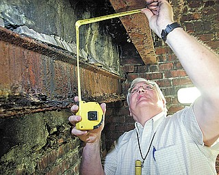 William Kostelic, a construction analyst from Poland, examines structural damage inside the Mahoning County Courthouse last June.