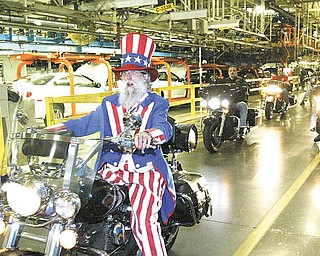 "Gary ""Bones"" Mowen of Niles, dressed as Uncle Sam, leads a group of motorcycles through the GM Lordstown plant Wednesday. More than 50 bikers who work at the plant or are retired took part in the 14th annual UAW GM Lordstown Bike Show. The event raised money for the March of Dimes."