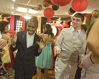 LISA-ANN ISHIHARA | THE VINDICATOR...Leon Brown and John Michael Snitzer of Campbell Memorial dance at the annual tri county special needs prom, held at Anthone's.