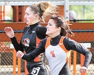 Seniors Sara Montgomery of Springfi eld, back, and Kristen Basista of Mineral Ridge run neck-and-neck in the 100-meter dash during the ITCL Championship track meet Thursday at Springfi eld High School. Basista came in second to Montgomery, but she was named girls MVP.