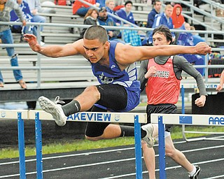 Lakeview's Toma Leveto clears a hurdle during the finals of the boys 110 meter hurdles during the All-American Conference White Tier meet Wednesday in Cortland. Leveto won the event and also won the long jump to help lead the Bulldogs to the team title.