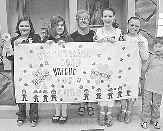 Students from St. Patrick School in Hubbard participated in the American Cancer Society Relay For Life at Youngstown State University. The funds they collected for the event and from students taking part in a dress-down day at school were donated to the ACS. Those forming Team Ealy and raising $1,797.04 for the cause included, from left, Camryn Ealy; Lily Mild; Mrs. Elaine Scott, first-grade teacher; Ainsley McDonald-Boyer, Sierra Lehman: and Aidan Ealy, a kindergarten student. Team members participating but not pictured are Megan Scutillo, Charity Unruh and Roberta Robinson.